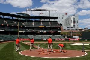 grounds crew in empty ballpark