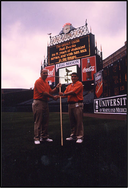 May 26, 2000: The official passing of the rake as I retired as Head Groundskeeper from the Baltimore Orioles. Al Capitos (right) accepts the rake from me in a pregame ceremony.