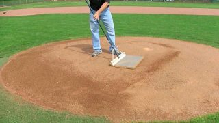 On the mound you can use a cocoa mop, around home plate use a steel mat or cocoa mat drag to finish things off.
